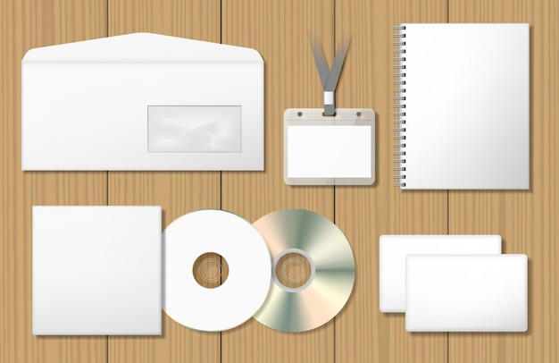 Blank corporate identity mock-ups set. notepad, cd cover, name tag badge, envelope, business card. Premium Vector