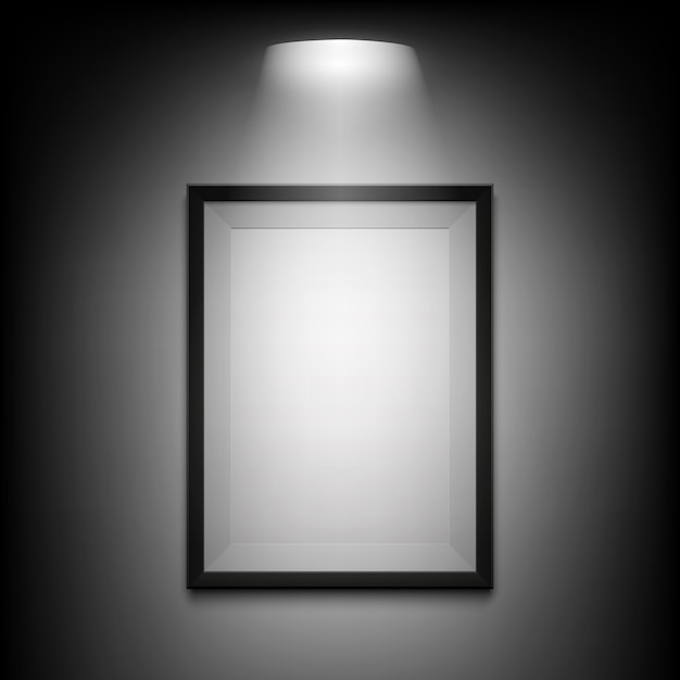 Blank illuminated picture frame on black background. Premium Vector