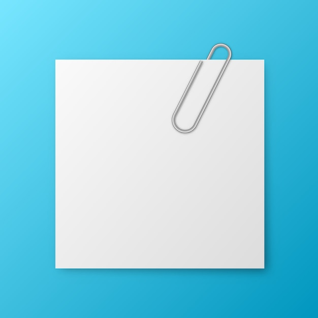 Blank note paper and metallic paper-clip Premium Vector