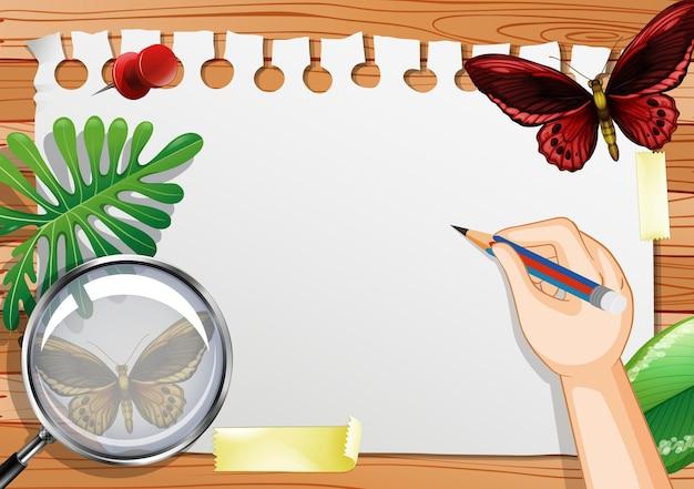Чистый лист бумаги на столе с элементами листьев и бабочек Бесплатные векторы