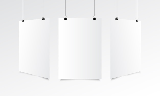 Blank poster realistic mock up with hanging Premium Vector