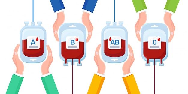 分離された手に赤いドロップと血液バッグ Premiumベクター