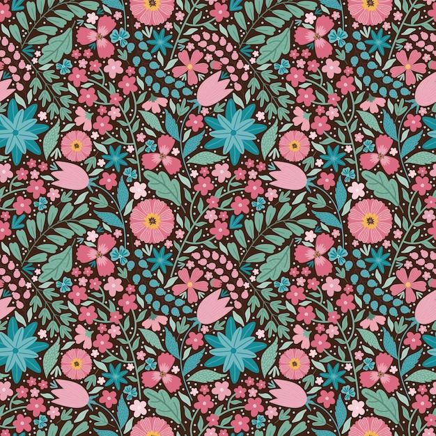 咲く真夏の牧草地のシームレスなパターン。カラフルな花、つぼみ、葉、茎の花の背景。フィールドにはさまざまな花がたくさんあります。リバティミレフルー。スカンジナビアスタイルのアートフローラル Premiumベクター