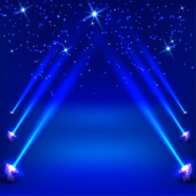 Синий абстрактный фон с лучами прожекторов. векторная иллюстрация Premium векторы