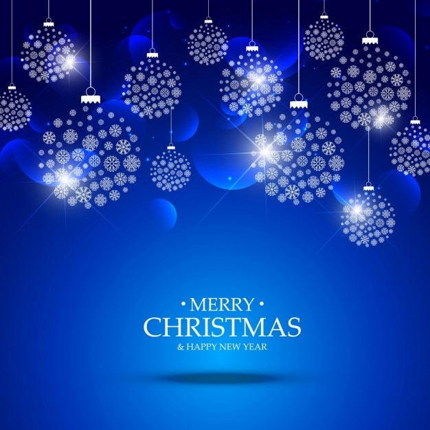 Blue background of christmas ball made of snowflakes Free Vector