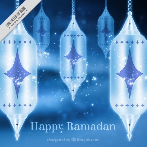 Blue background of ramadan with lanterns