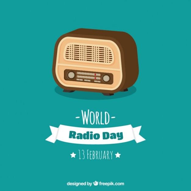 Blue background of retro radio in flat design