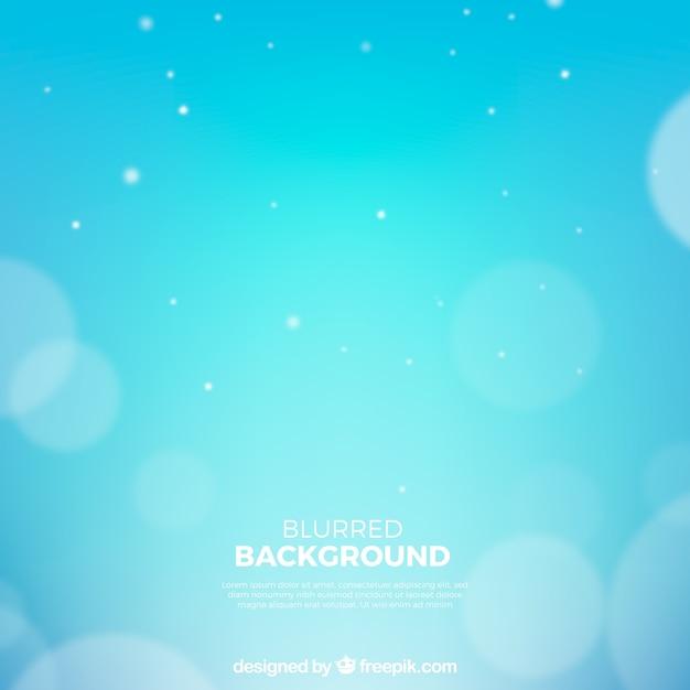 Sfondo blu con effetto bokeh Vettore gratuito