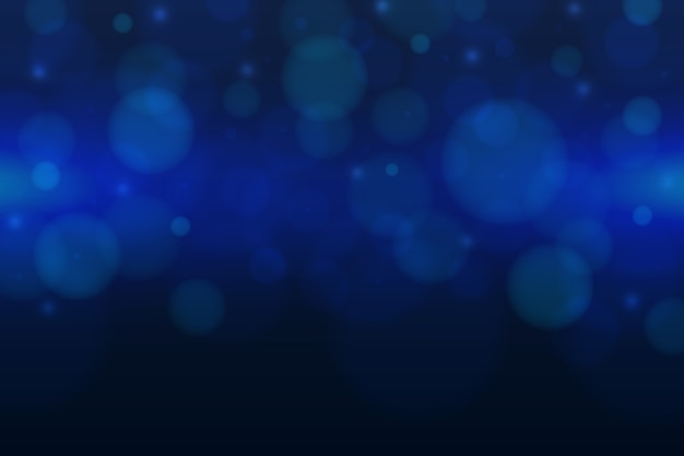 Blue background with bokeh effect Free Vector