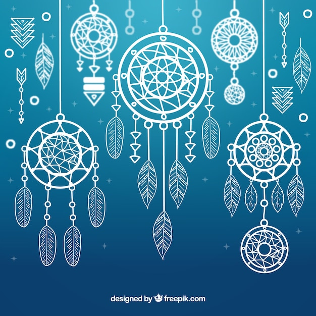 Blue background with ornamental dream catchers Free Vector