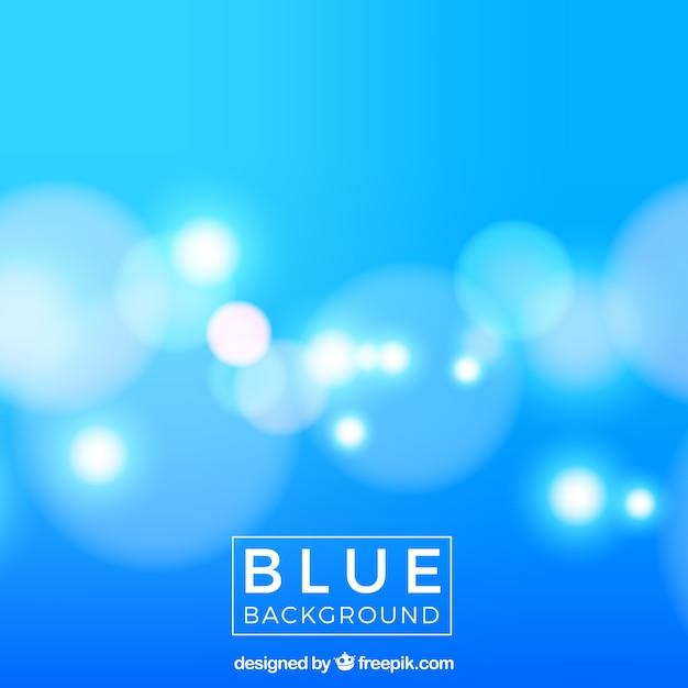 Blue blurred background with lights Free Vector