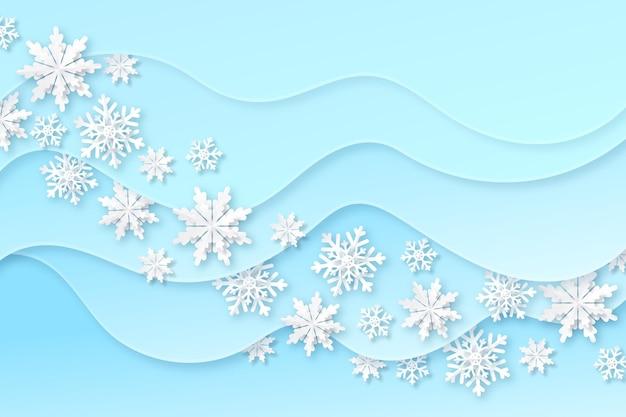 Синий размытый зимний фон со снежинками Бесплатные векторы
