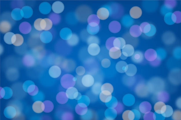 Blue bokeh background Free Vector