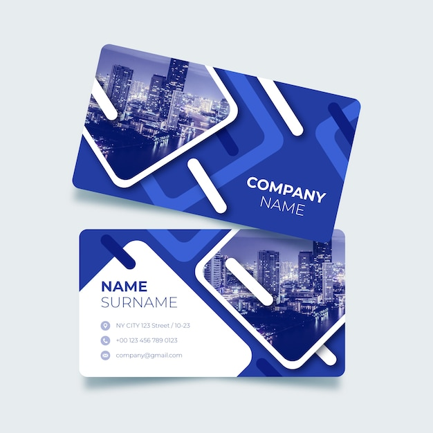 Blue business card with abstract shapes Free Vector