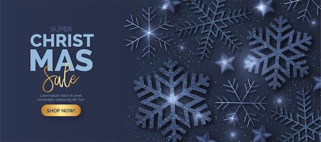 Синий рождественский баннер продаж с блестящими снежинками Бесплатные векторы