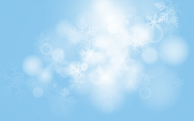 Blue christmas snowflakes background with abstract bokeh light Premium Vector