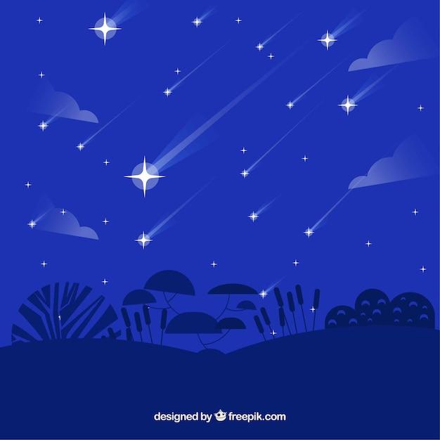 Синий плоский фон с падающими звездами Бесплатные векторы