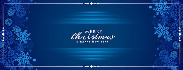 Синий с рождеством баннер со снежинками Бесплатные векторы