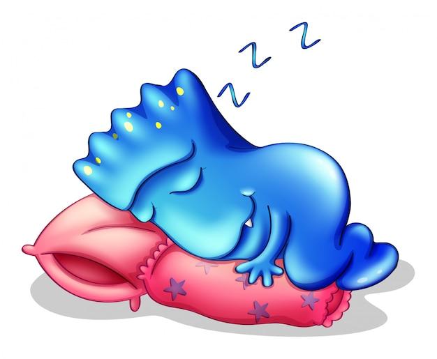 A blue monster sleeping above a pillow Free Vector