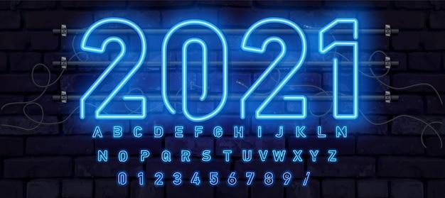 青いネオンフォント、完全なアルファベットと数字。輝くアルファベット、電気スタンド、レンガの壁の背景、電気abc。 Premiumベクター
