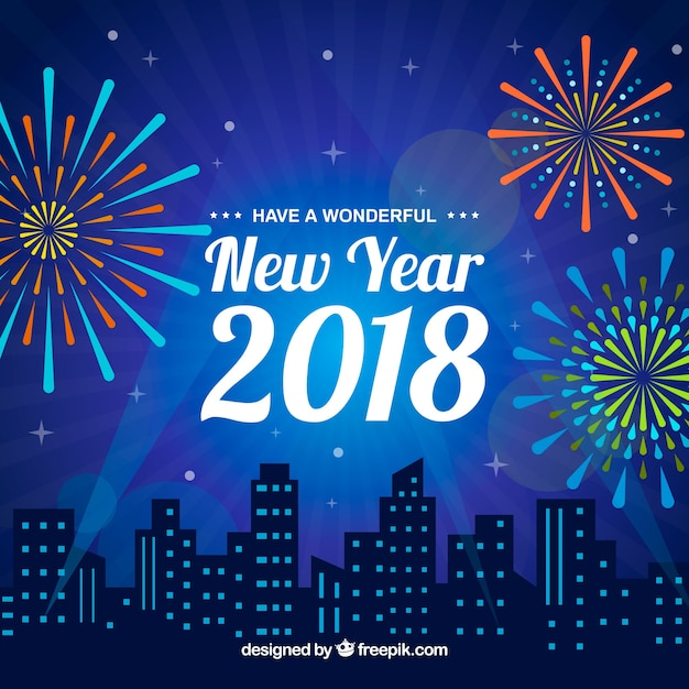 blue new year background with a city and fireworks free vector