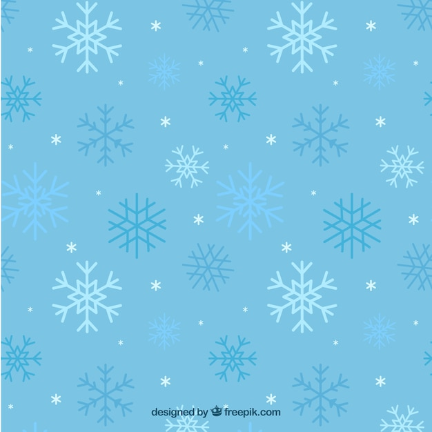 Blue pattern of snowflakes Free Vector