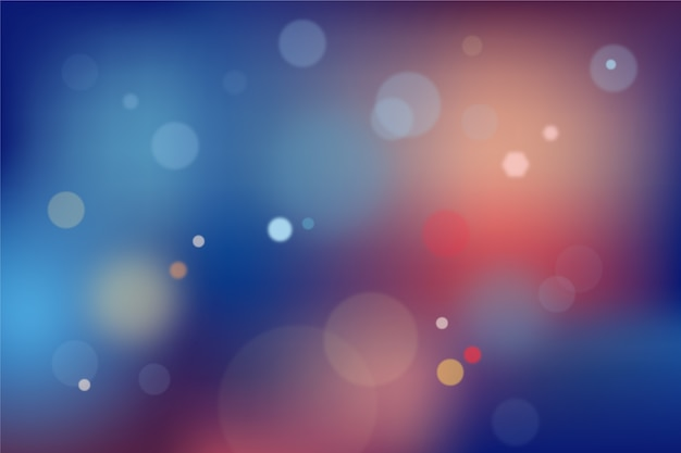 Blue and red gradient background with bokeh effect Free Vector