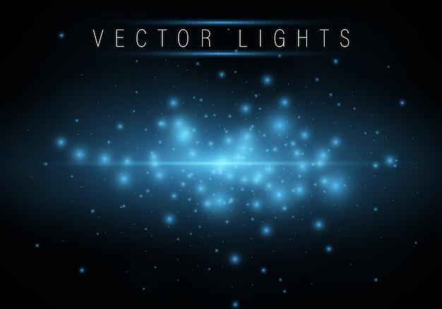 Blue shining magic light circles and defocused particles Premium Vector
