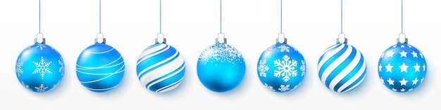 Blue shiny glowing and transparent christmas balls. holiday decoration Premium Vector