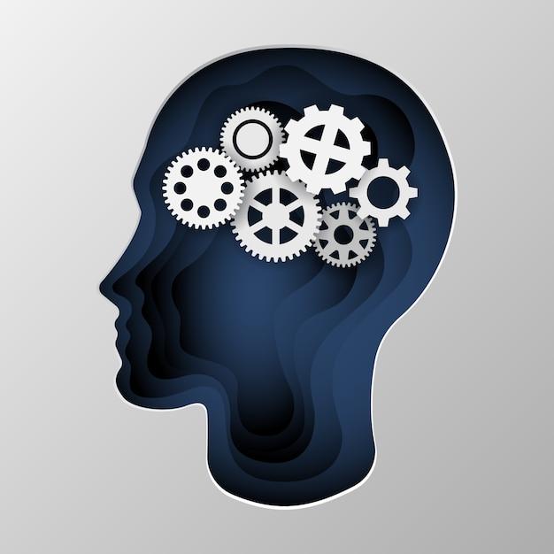 紙に刻まれた男の頭の青いシルエット。 Premiumベクター