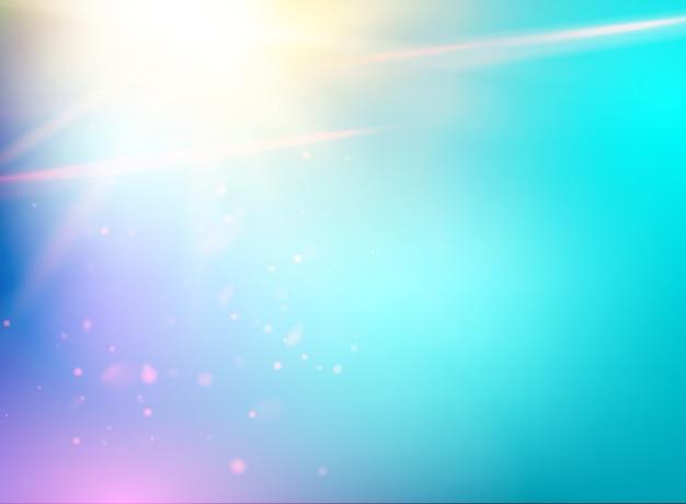 青い空と抽象的な光のフラッシュの背景。 無料ベクター