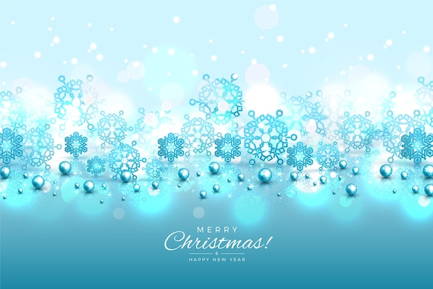 Blue snowflakes background with glitter effect Free Vector