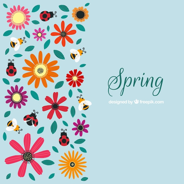 blue spring background with pretty flowers and insects