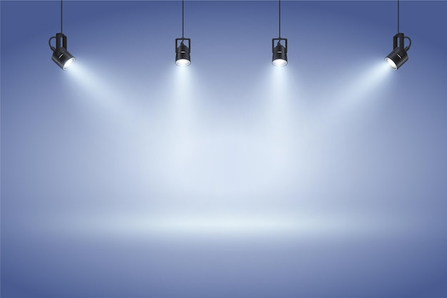 Blue wall with spot lights background Free Vector