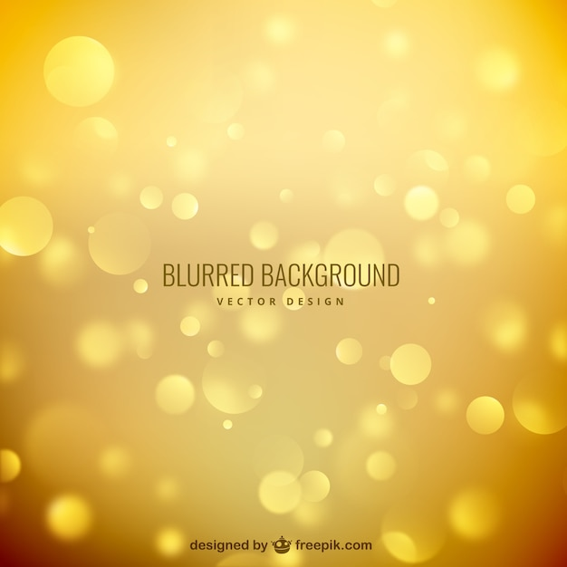 Blurred background in golden tones Premium Vector