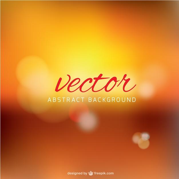 Blurred background in orange tones Free Vector