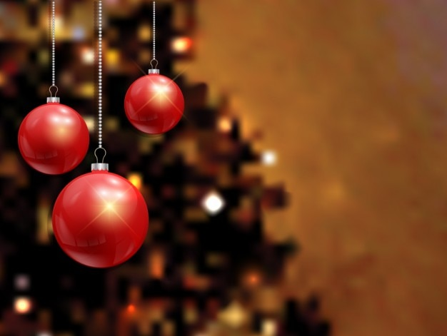 Blurred background with red baubles Free Vector