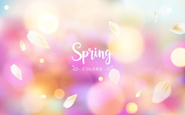 Blurred background with spring colors lettering Free Vector