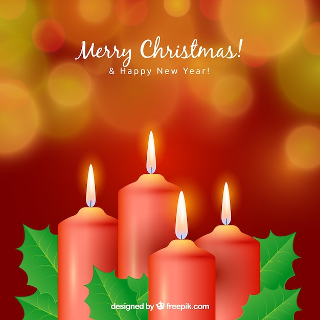 Blurred christmas background with four red candles Free Vector