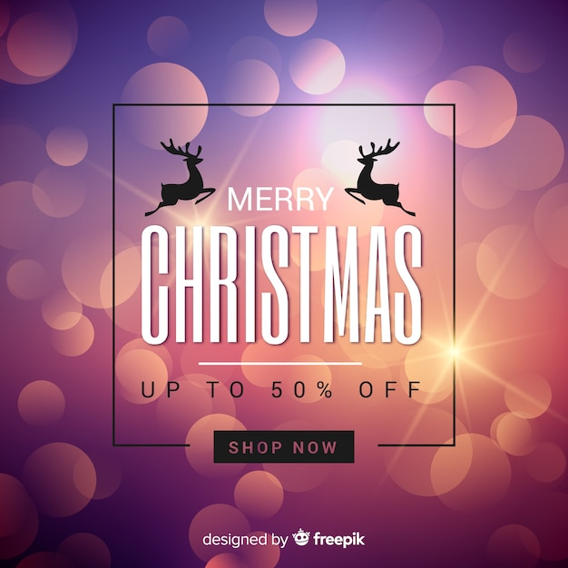 Blurred christmas sale background Free Vector