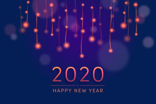 Blurred new year 2020 wallpaper Free Vector