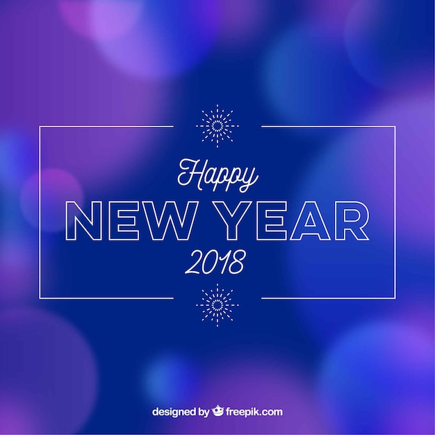 Blurred new year background in blue and purple
