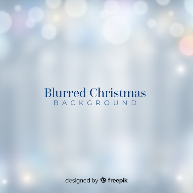 Blurred silver christmas lights background Free Vector