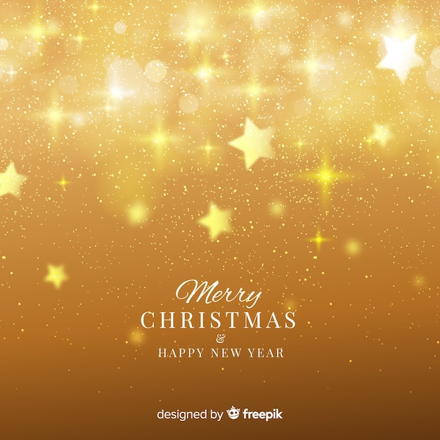 Blurred stars christmas background Free Vector