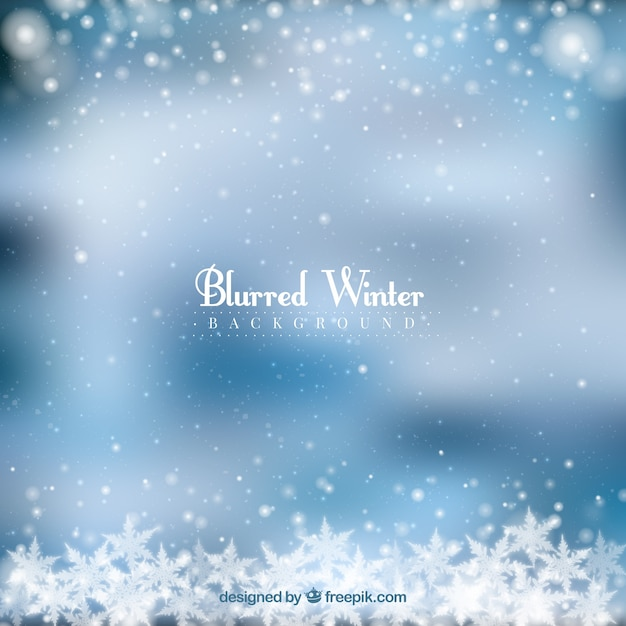 Blurred winter background in a frozen frame Free Vector