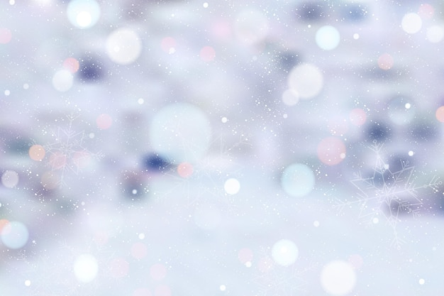 Blurred winter background with snow Free Vector
