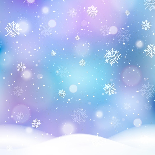 Размытый зимний фон со снежинками Premium векторы