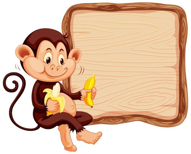 白い背景の上のかわいい猿のボードテンプレート 無料ベクター