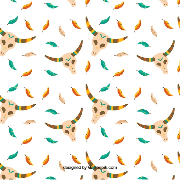 Boho pattern with feathers and skulls Free Vector