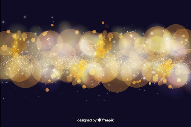Bokeh background with golden particles Free Vector